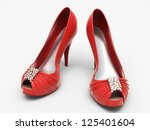 women's red shoes closeup on a... | Shutterstock . vector #125401604
