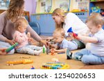 friends with children toddlers... | Shutterstock . vector #1254020653
