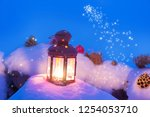 lantern with candle on snow... | Shutterstock . vector #1254053710