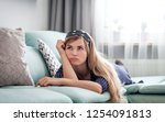 sad disappointed woman lying on ... | Shutterstock . vector #1254091813