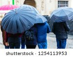 crowds of people with umbrellas ...   Shutterstock . vector #1254113953