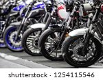 motorcycles parked on the... | Shutterstock . vector #1254115546