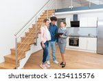 young couple getting tour... | Shutterstock . vector #1254115576