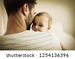 father holding his baby girl at ... | Shutterstock . vector #1254136396