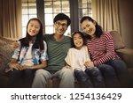 portrait of smiling family...   Shutterstock . vector #1254136429