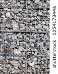 photograph of gabion baskets... | Shutterstock . vector #1254173446