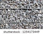 photograph of gabion baskets... | Shutterstock . vector #1254173449