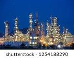 twilight scene of oil refinery... | Shutterstock . vector #1254188290