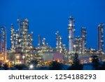 twilight scene of oil refinery... | Shutterstock . vector #1254188293