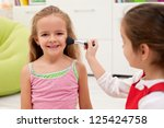 happy little girl smiling while ... | Shutterstock . vector #125424758