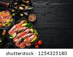 seafood. shrimp and mussels in... | Shutterstock . vector #1254325180