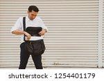 businessman wearing white t... | Shutterstock . vector #1254401179
