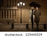 Elegant Couple With Umbrella...