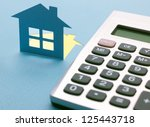 paper house with calculator on... | Shutterstock . vector #125443718
