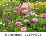 Happy Little Girl Smelling The...