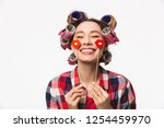 cheerful housewife with curlers ... | Shutterstock . vector #1254459970