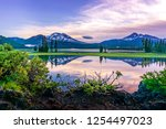 mountain and sky reflection in... | Shutterstock . vector #1254497023