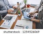 business casual team meeting... | Shutterstock . vector #1254526069