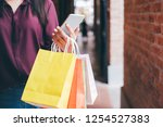 consumerism  shopping ... | Shutterstock . vector #1254527383