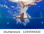 happy family in swimming pool.... | Shutterstock . vector #1254544333