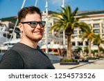 portrait of man yachts and dock ... | Shutterstock . vector #1254573526