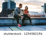 man and woman in fitness... | Shutterstock . vector #1254582196