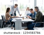 sharing opinions. group of... | Shutterstock . vector #1254583786