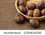 fresh edible chestnuts in a... | Shutterstock . vector #1254616330