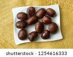 ripe chestnuts close up. raw... | Shutterstock . vector #1254616333