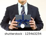 Businessman Show Gift Box For...