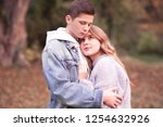 love teenage couple holding... | Shutterstock . vector #1254632926