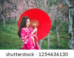asia woman with kimono and red... | Shutterstock . vector #1254636130