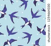 Stock vector swallow bird pattern 1254664330
