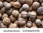 dry walnuts background   Shutterstock . vector #1254669250
