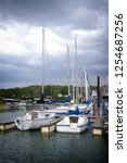 sail boats in a dock at lake in ... | Shutterstock . vector #1254687256
