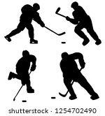 silhouettes of hockey players... | Shutterstock .eps vector #1254702490