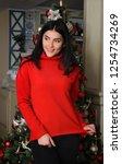 young girl near next to a... | Shutterstock . vector #1254734269