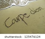 Carpe Diem Phrase In Sand On...