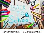 alarm clock on wooden table on... | Shutterstock . vector #1254818956