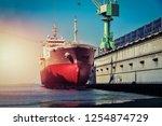 cargo ship moored under repair... | Shutterstock . vector #1254874729