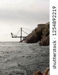 abandoned dock ocean rocks | Shutterstock . vector #1254892219