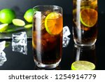 two glasses of cuba libre... | Shutterstock . vector #1254914779