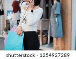 pretty happy girl talking on... | Shutterstock . vector #1254927289