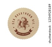 sea buckthorn oil emblem with... | Shutterstock .eps vector #1254928189
