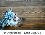 bar desk with ice cubes and... | Shutterstock . vector #1255038736