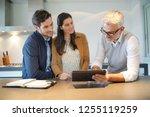 kitchen salesman going through ... | Shutterstock . vector #1255119259