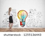 side view of young blonde... | Shutterstock . vector #1255136443