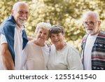 group of senior friends smiling ... | Shutterstock . vector #1255141540
