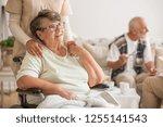 happy senior lady sitting at... | Shutterstock . vector #1255141543
