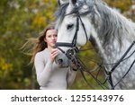 young woman with a horse for a... | Shutterstock . vector #1255143976